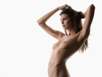 Zoi   Topless woman against white